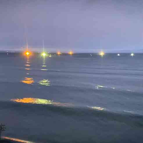 Fishing boats at night after air cleared